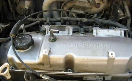 Масло в двигатель Митсубиси Лансер 9: выбор, замена
